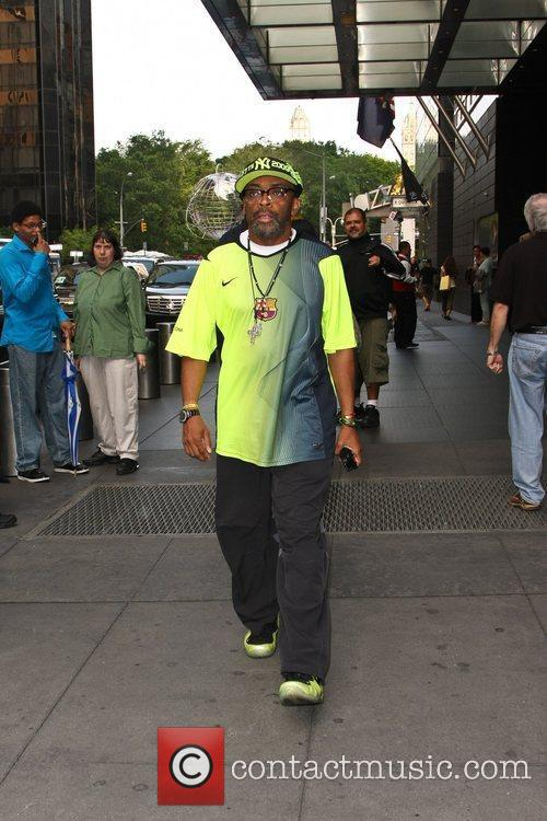 Spike Lee leaving his hotel wearing matching green...