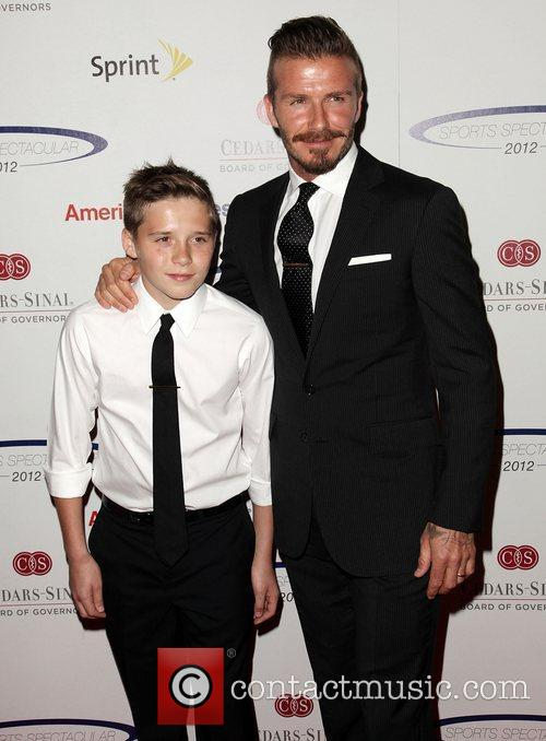 Brooklyn Beckham and father David