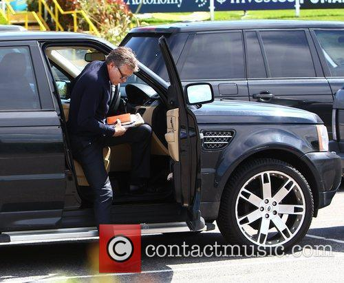 Assistant manager Kevin Bond with his Range Rover...