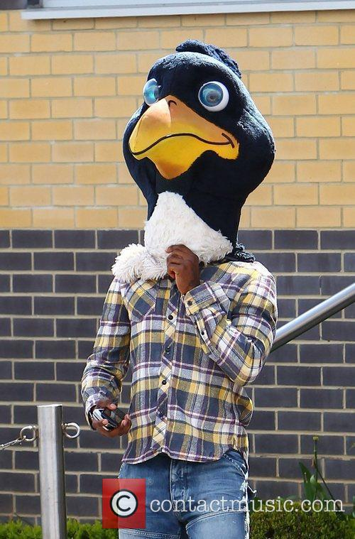 Jermain Defoe (wearing the cockerel mascot head) Tottenham...