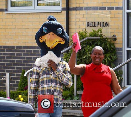 Jermain Defoe (wearing the cockerel mascot head) with...