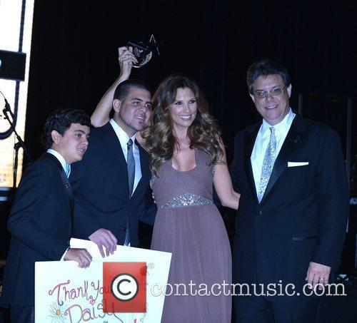 Daisy Fuentes with Stephan, Carlos and Julio Barrionuevo...