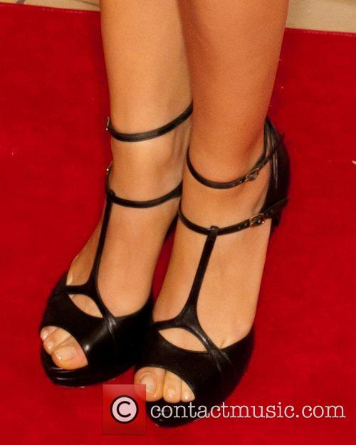 Mila Kunis and Beverly Hilton Hotel 1