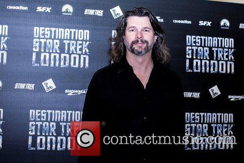 Ronald D Moore Celebrities pose for photographers, without...