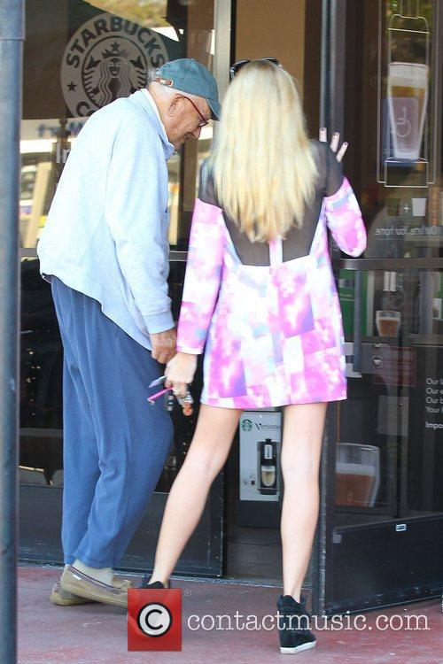 Stephanie Pratt seen holding the door at Starbucks...