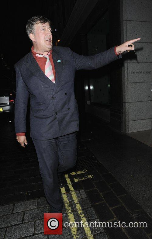 Stephen Fry walking in Mayfair London, England