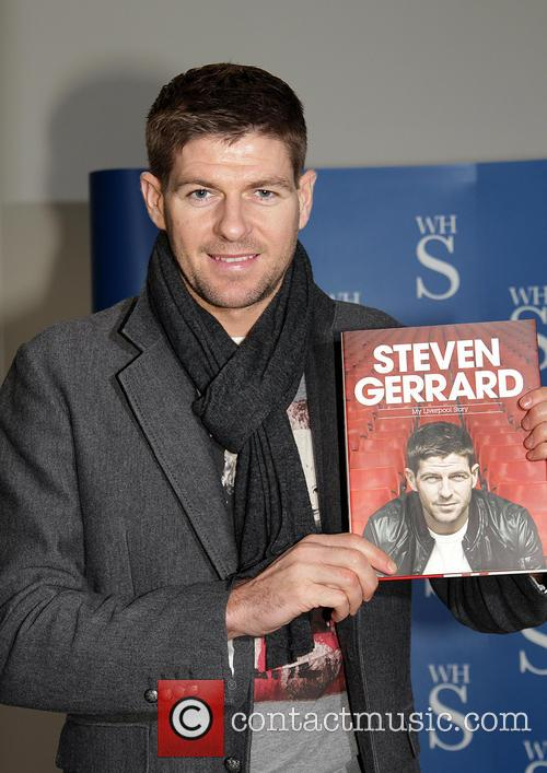 Steven Gerrard Steven Gerrard signs copies of his...