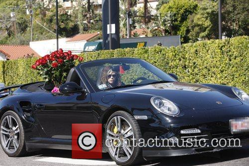 Seen driving in Los Angeles with a bouquet...