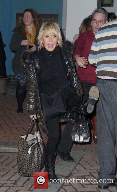 Lulu arrives back at her hotel,  at...