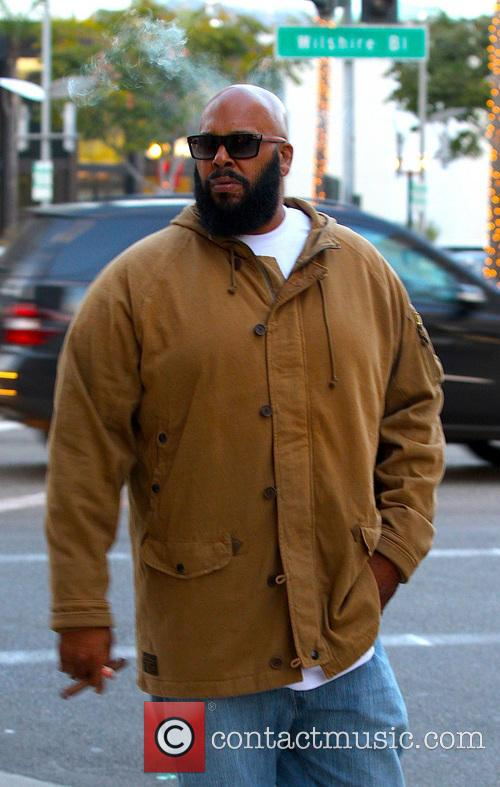 Hip-Hop Producer Suge Knight sighted smoking a cigar...