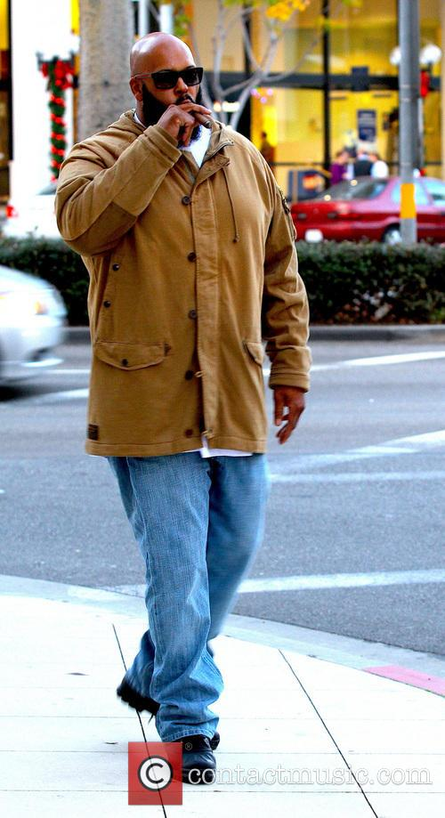 Suge Knight Hip-Hop Producer Suge Knight sighted smoking...