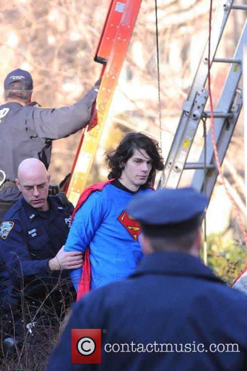 A man dressed in a Superman costume protests...