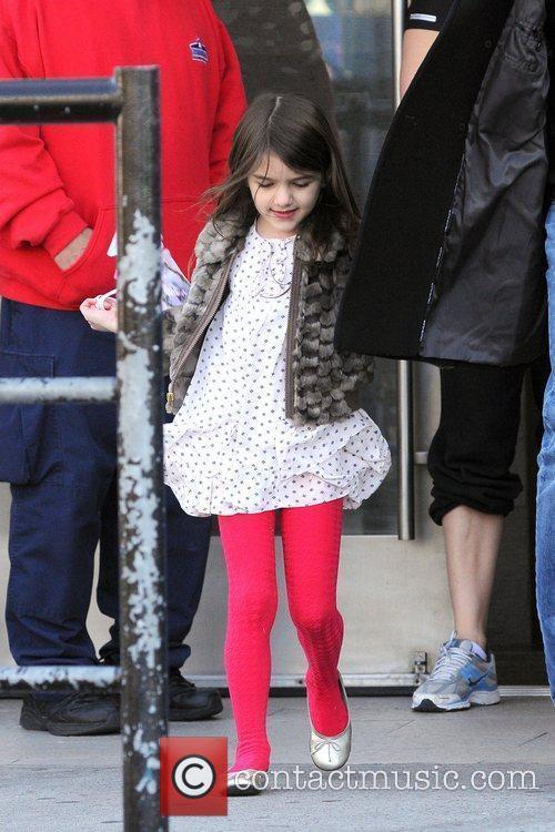 Suri Cruise walking with her bodyguard in Manhattan...