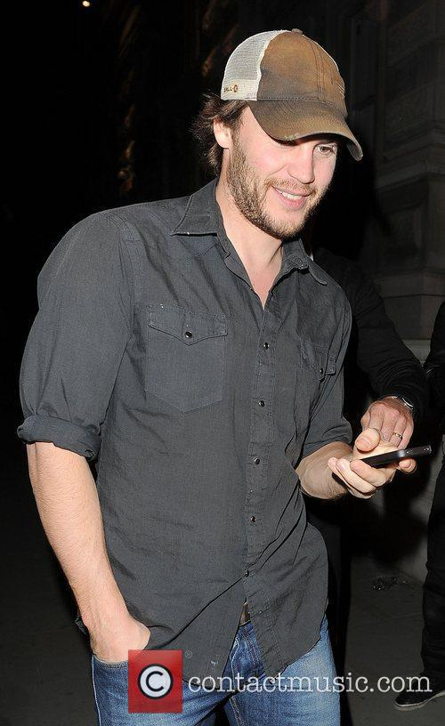 Taylor Kitsch arriving back at his hotel.