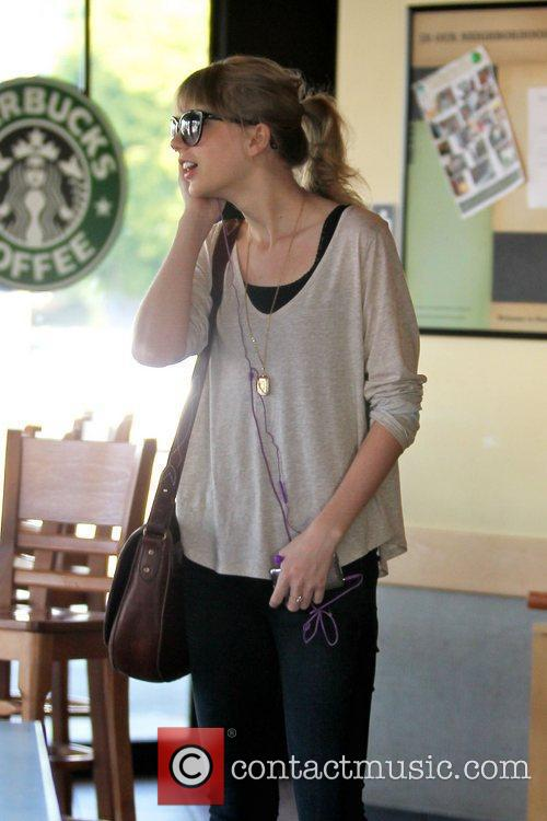 Taylor Swift gets a coffee at Starbucks in...