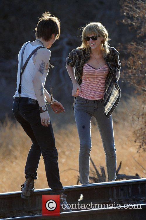 Singer Taylor Swift, Reeve Carney, I Knew You Were, Trouble and Palmdale 23