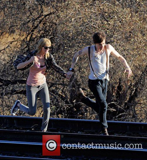 Singer Taylor Swift, Reeve Carney, I Knew You Were, Trouble and Palmdale 24