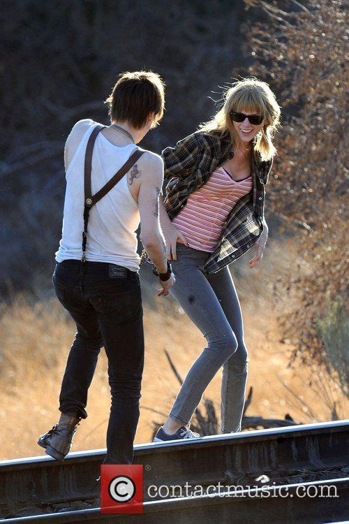 Singer Taylor Swift, Reeve Carney, I Knew You Were, Trouble and Palmdale 12