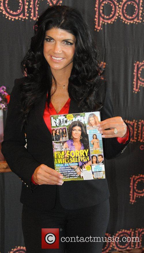 Teresa Giudice, signed a copy of InTouch for...