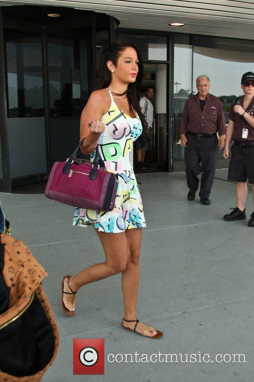 Tulisa Contostavlos arrives at LaGuardia airport New York...