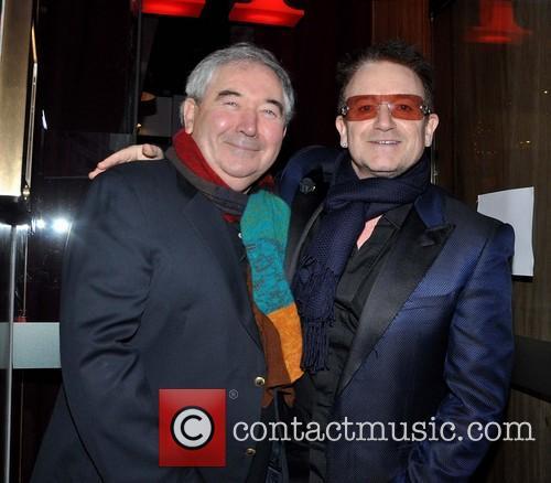 Members of U2 outside Harry Crosbie's Cafe Bar...
