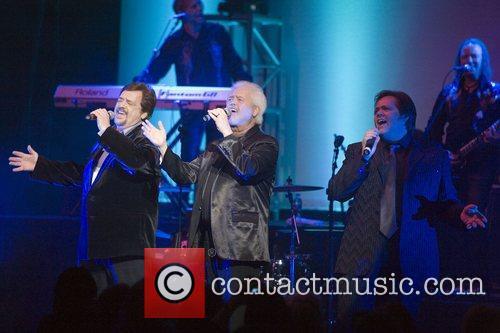 Jay Osmond, Merrill Osmond and Jimmy Osmond performing...