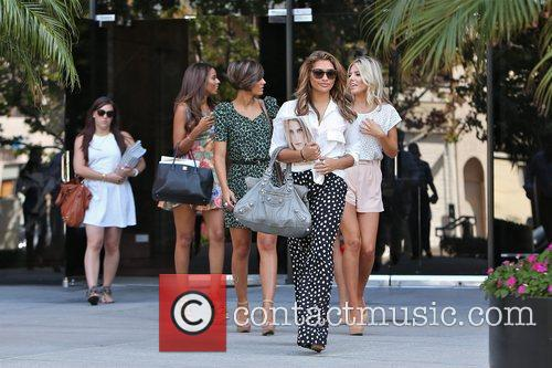 The Saturdays  exits an office building in...