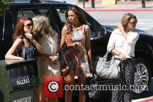 The Saturdays leave an office building in Beverly...