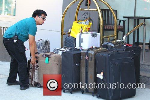 The Saturdays luggage outside their hotel Una Healy,...