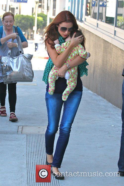 Una Healy holds daughter Aoife Belle Foden with...