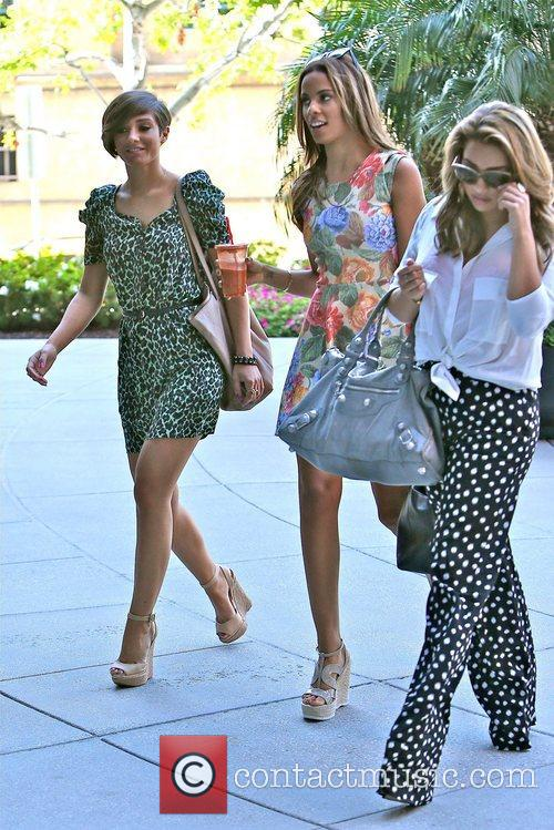The Saturdays  arrive for a business meeting...