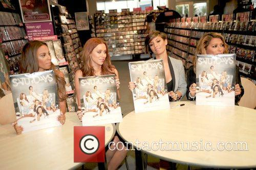 The Saturdays signing at the HMV store in...