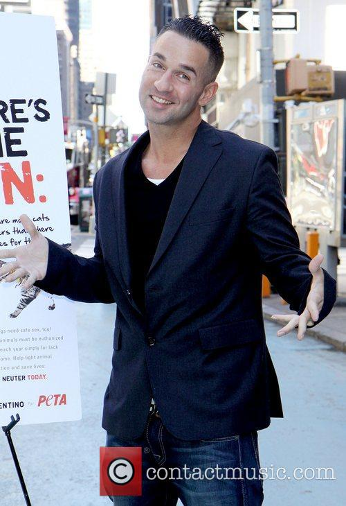 Attends a photocall in Times Square for PETA's...