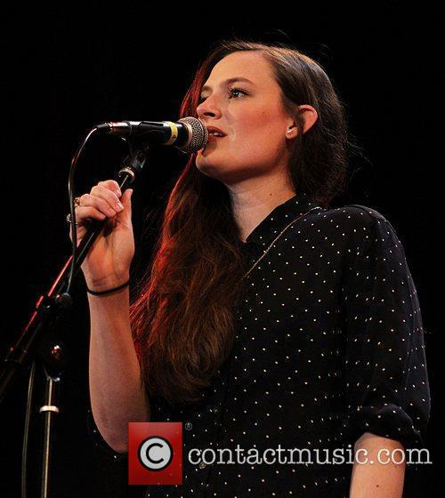 Camilla Staveley-Taylor of The Staves performing on stage...