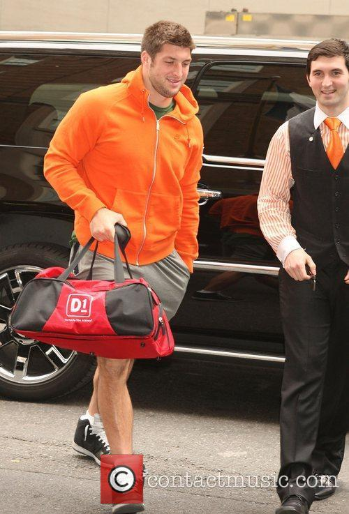 Tim Tebow arriving at his hotel in an...