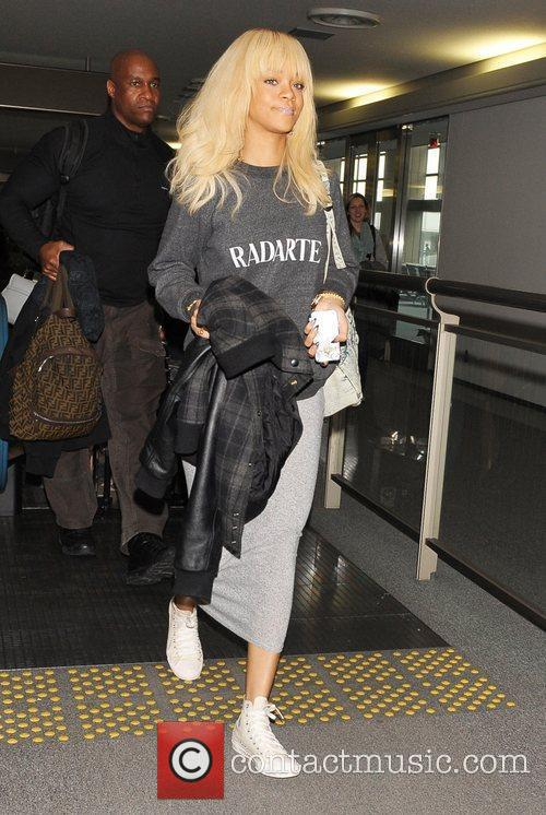 Rihanna arrives at Narita International Airport after flying...
