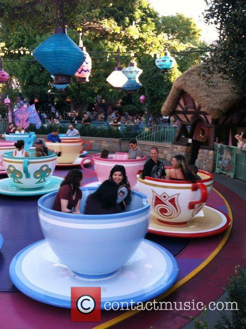 Enjoying a ride in the tea cups at...