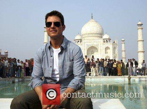 Tom Cruise poses with fans at the Taj...