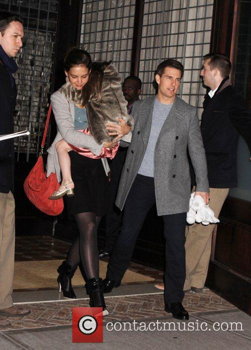 Katie Holmes and Tom Cruise take their daughter...