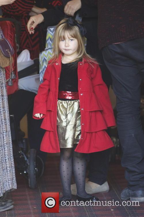 Tori Spelling and her family visit Santa Claus...