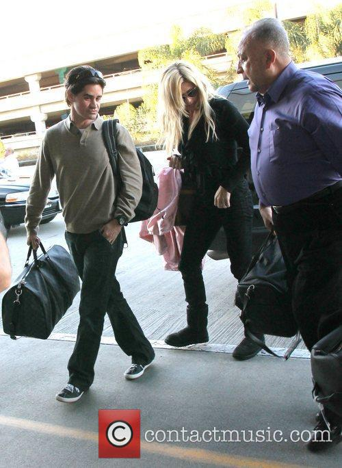 Torrie Wilson arrives to LAX airport with a...