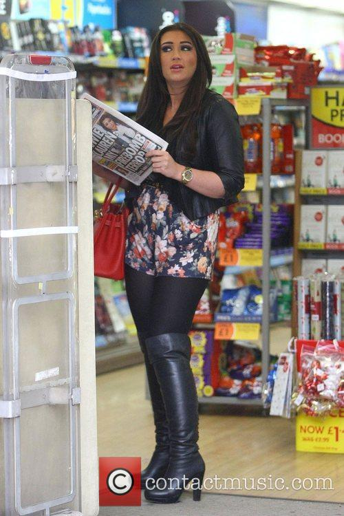 Lauren Goodger buys a copy of the Daily...