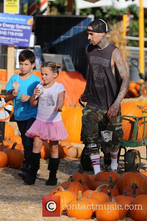 Travis Barker seen with his children Landon and...