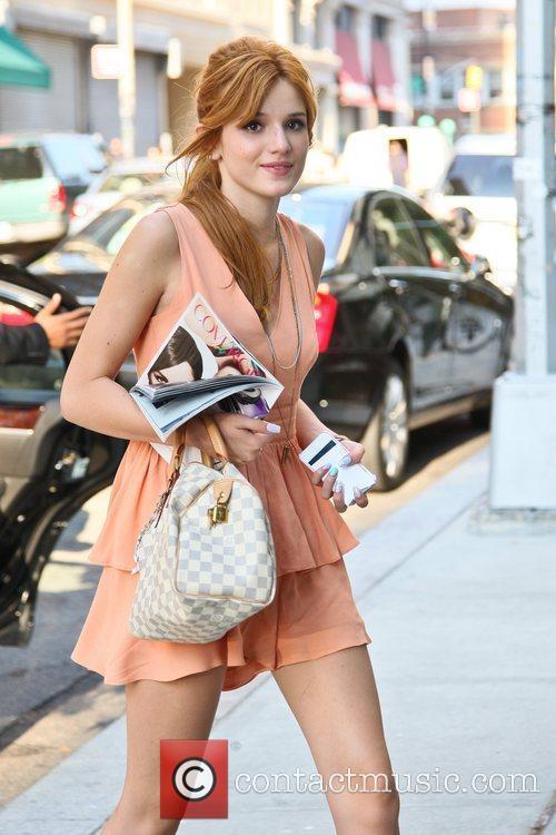 Actress Bella Thorne seen wearing a peach dress...