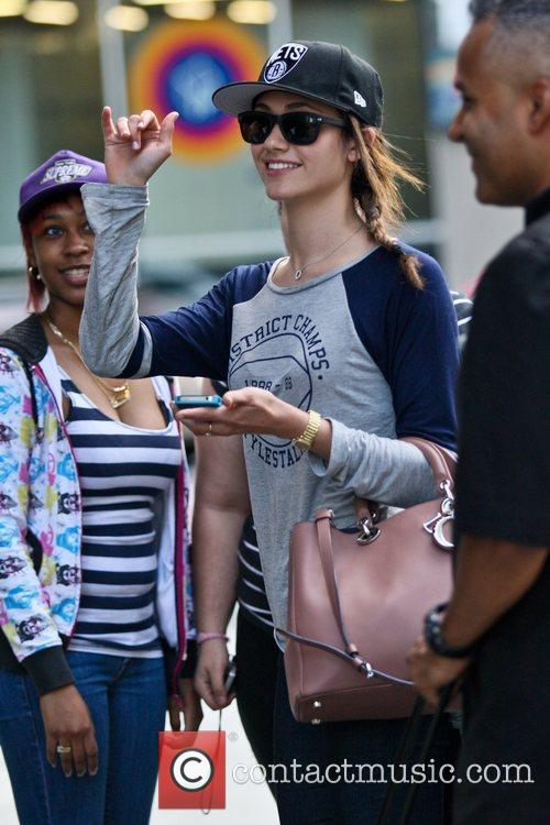 emmy rossum poses for photographs withfans outside 5887809