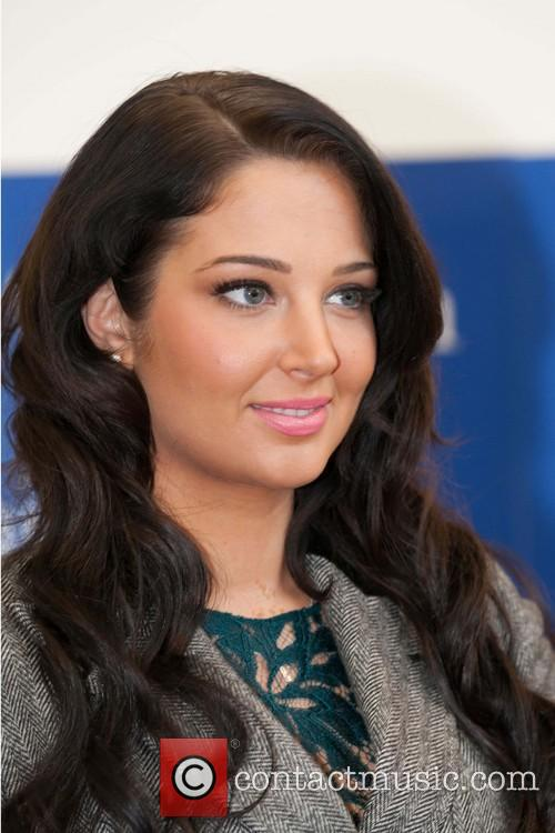 Tulisa Contostavlos Tulisa Contostavlos promotes and signs copies...