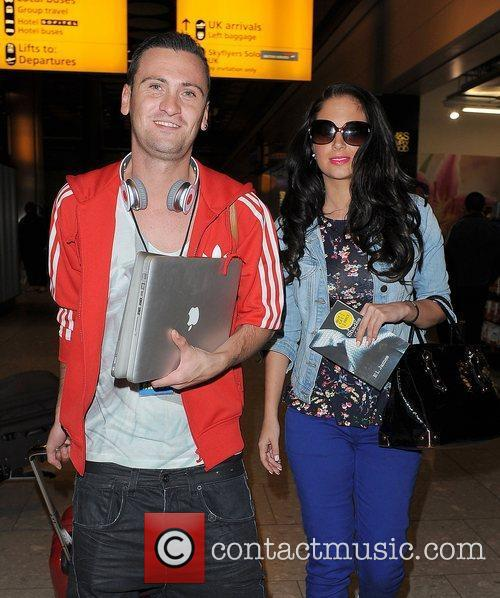 tulisa contostavlos arriving at heathrow airport on 3894498