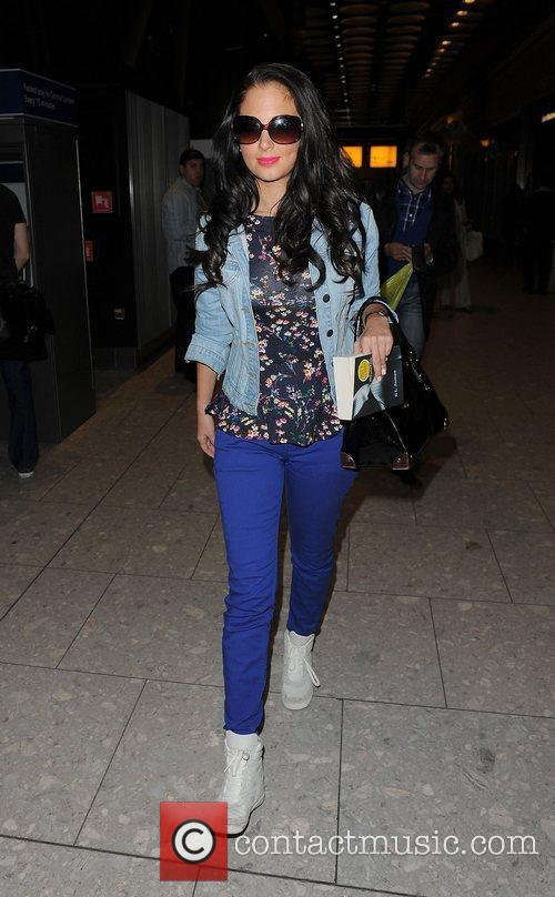 Tulisa Contostavlos arriving at Heathrow Airport on a...
