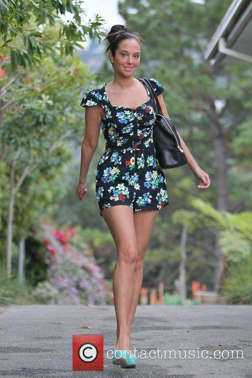 Tulisa Contostavlos in a summer playsuit, arrives at...