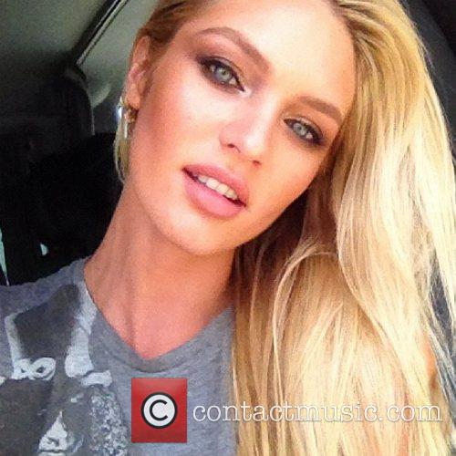 Candice Swanepoel tweets this pic with the caption,...